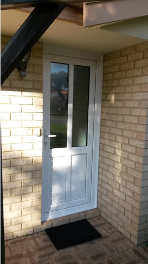 Custom door with glazing